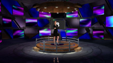 Virtual Set Studio 101 for Wirecast is a presentation room with monitors around the perimeter.