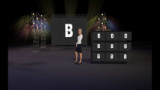 Virtual Set Studio 111 for Wirecast is a stage with various screens and lots of colorful lighting.