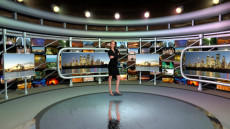 Virtual Set Studio 113 for Wirecast is a circular room with presentation monitors all around it.
