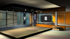 Virtual Set Studio 115 for Wirecast is an office with screen overlooking buildings.