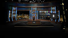 Virtual Set Studio 159 for HD is a major network new desk set with monitors spaced around the room.