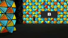 Virtual Set Studio 198 for Wirecast is an colorful geometric wall with a screen.