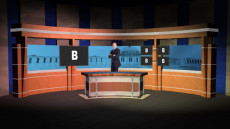 Virtual Set Studio 103 for Wirecast is a newsdesk with a wireframe of the capital in the background.