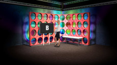 Virtual Set Studio 129 for After Effects is a trendy interview set with a red wall and monitor.