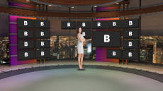 Virtual Set Studio 178 for After Effects is a circular room with screens and a view of a skyline.